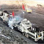 Mobile rock crusher in open pit mine